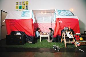Enjoy your croissant sandwich and pistachio latte inside Cafe Darak's Volkswagen bus tent.