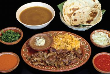 You deserve Tacos El Rodeo's lamb barbacoa and all the fixings.