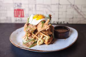 Fried Jidori chicken and green chili cornbread waffles are a brunch and dinner favorite at Public School 702.