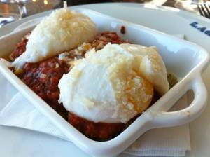 Lago's poached egg-topped lasagna with meat sauce.