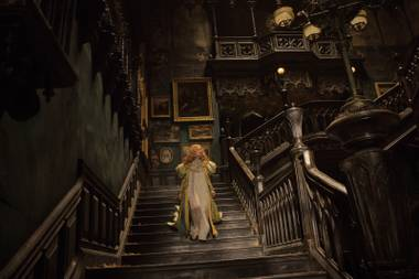 Home sweet home: Mia Wasikowska wanders through her creepy abode in Crimson Peak.