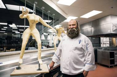 Chef Robert Teddy with the rough foundation of Jewel Frost, a character of chocolate, cake, icing, sugar glass and even a cookie tiara that will be part of a fantastical holiday display to be unveiled at Neiman Marcus December 12.