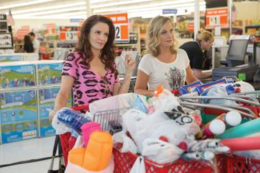 Bargain hunting: Fey and Poehler stock up on party supplies in Sisters.