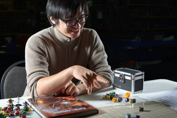 Dungeon Master Jonathan Tamahiro happily leads a game of D&D at Empire Game Shop.