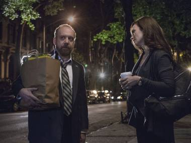 Giamatti and Siff conspire over groceries.