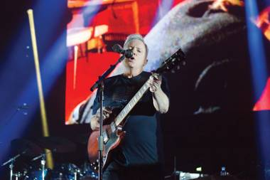 Frontman Bernard Sumner sings to the devoted.