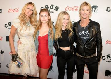Susan Holmes-McKagan, left, and Guns N' Roses' Duff McKagan, right.