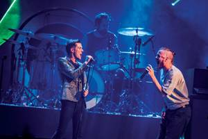 Imagine Dragons' Dan Reynolds joins the Killers onstage during T-Mobile Arena's opening night.