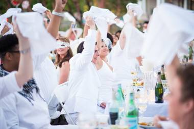 From the DJ in her egg-shaped cage to the acrobats performing on twisted-metal art to the servers shepherding chilled white wine among a crowd of more than 1,000 diners, everyone was dressed in white.