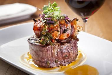 Crush's Surf and Turf, filet of beef and lobster tail with chimichurri vinaigrette.