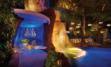 Catch the pyro show, dance or just relax near the cascading waterfall at Intrigue's new patio bar.
