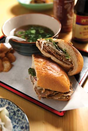 Le Pho's <em>pho</em> dipped sandwich, a creative take on the French dip with a side bowl of <em>pho</em> for dipping.