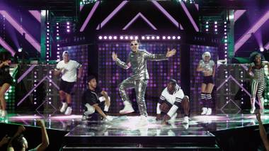 Andy Samberg (center) in one of his more subdued outfits as pop star Conner4Real in Never Stop Never Stopping.
