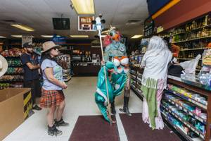 "Aaron Sheppard stops in a liquor store to buy supplies during ""Bearded and Shucked"", the 1st Annual  Mermaid Parade in Joshua Tree, CA on June 18, 2016."