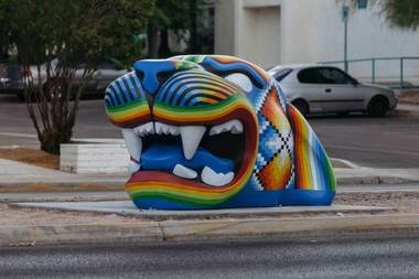 A jaguar head by Miguel Rodriguez for Clark County's Centered Art Project adorns the traffic median outside Winchester Cultural Center, 3130 McLeod Drive, June 29, 2016.