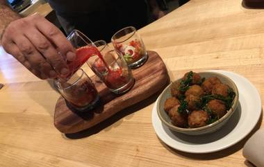 Sampling Libertine Social's strawberry gazpacho and Scotch olives.