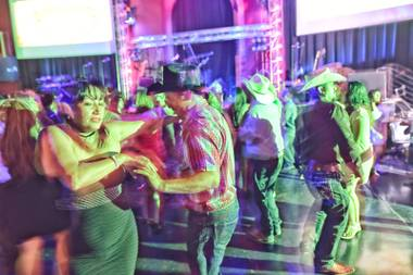 Patrons dance to live music by Banda Destructora at Club Tequila, a latin-themed nightclub, located inside Fiesta Rancho Hotel and Casino, Saturday, Aug. 13, 2016.
