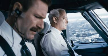 "Aaron Eckhart, left and Tom Hanks in ""Sully."""