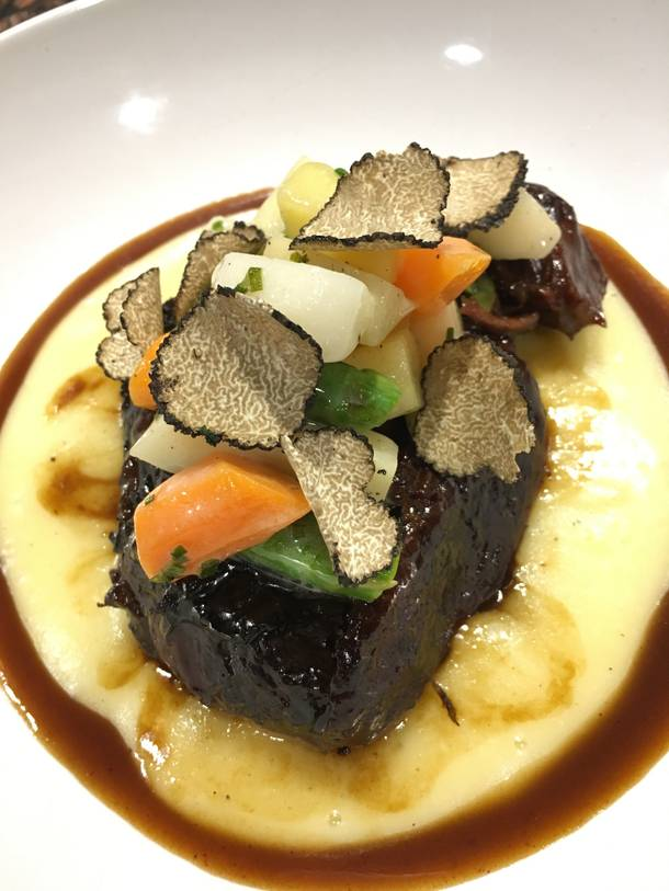 Glutton's barolo-braised beef cheek with shaved black truffle.