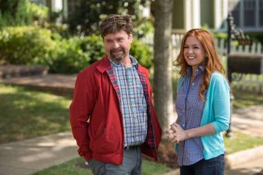 Zach Galifianakis and Isla Fisher are trying to keep up with the Joneses.