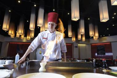 Benihana's Brandon Yenglin teaches a newbie chef the ropes.