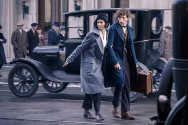 Katherine Waterston and Eddie Redmayne hunt down fantastic beasts.