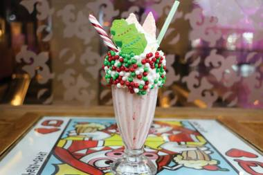 The Candy Cane Bam-Boozled Shake combines rich vanilla ice cream and peppermint schnapps with crushed candy canes, peppermint glaze and more.