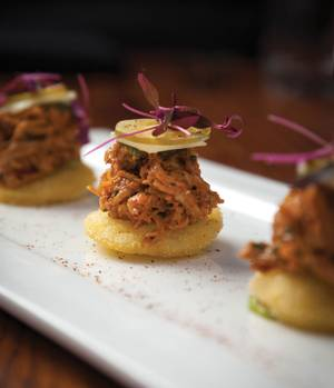 "Pretty little pulled chicken ""arepas"" at Beauty & Essex."