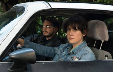 Melanie Lynskey and Elijah Wood stake out their targets.