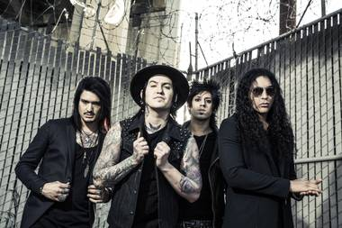 Oritz, far right, and Escape the Fate play Las Rageous Saturday at 6:50 p.m.