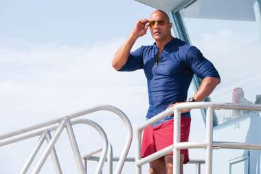 Dwayne Johnson rocks his Baywatch outfit.