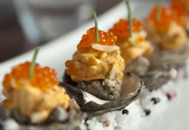 Standard & Pour's deviled eggs feature srirachca and roe.