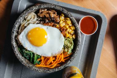 Served in a hot stone bowl, rice, vegetables and protein continue to cook as you eat.