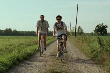 Hammer (left) and Chalamet take a ride in Call Me by Your Name.