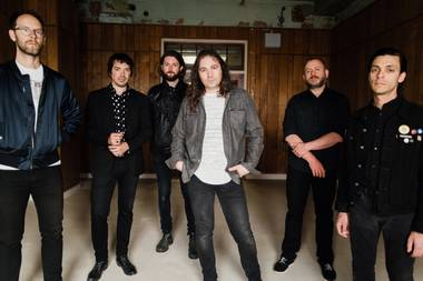Hartley (far left), Granduciel (third from right) and their War on Drugs mates play Brooklyn Bowl on April 11.