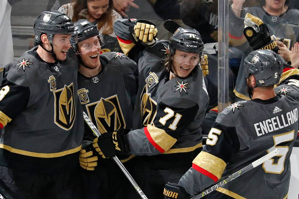 68080c93d2f Vegas Golden Knights players celebrate a goal by William Karlsson (71) on  March 31.