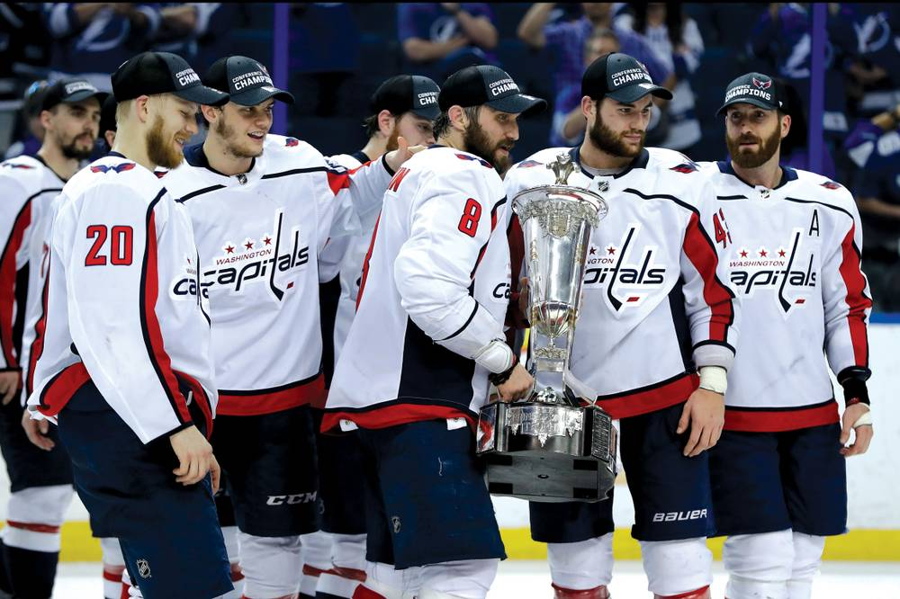 236f8d0f39f Team members of the Washington Capitals hold the NHL Eastern Conference championship  trophy