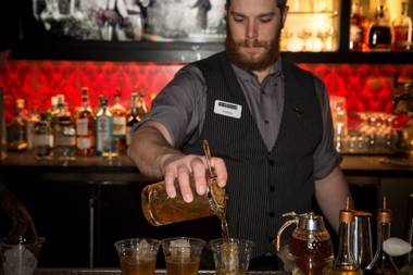 Modeled after a Prohibition-era speakeasy, here you can learn about the past through drinking it.