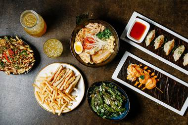 Tomo's fries, ramen, chicken katsu sandwich, shishito peppers, shrimp skewers and gyoza dumplings.