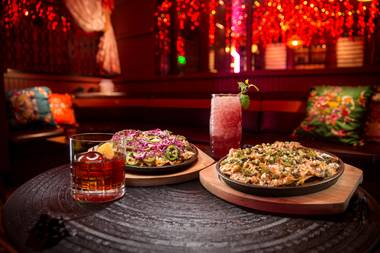 Have a couple Mole Negronis and you'll need a snack. That's where the infamous truffle nachos come into the picture.