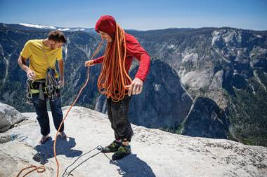 A screen grab from Free Solo with Alex Honnold, right.