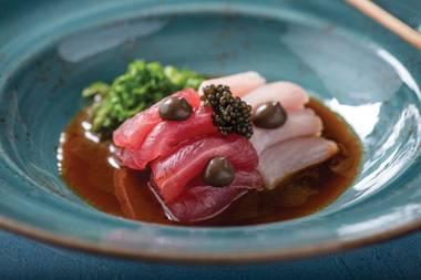 The signature truffle sashimi is without a doubt one of Vegas' best new dishes this year.