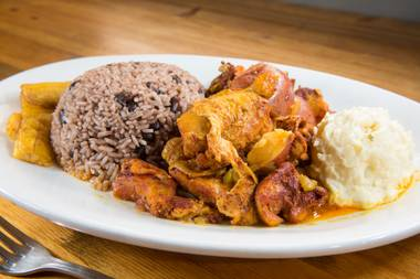 The bone-in bird is slow-cooked in a sauce based on achiote, a reddish-orange spice, which lends an earthy, slightly peppery tang to the tender poultry.