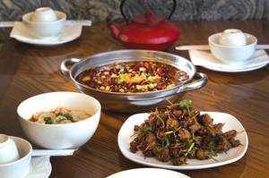 Toothpick lamb with cumin, fish with tofu pudding in hot sauce and wonton in red chili at Chengdu Taste. <em>(Steve Marcus/Staff)</em>