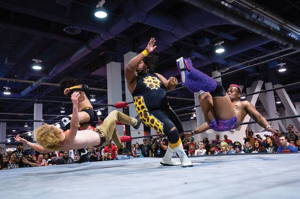 Wrestlers perform during a Versus Pro Wrestling match at the LVL Up Expo. (Wade Vandervort/Staff)