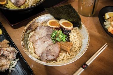 The southwest eatery's Black on Black bowl arrives as a beautiful cauldron of egg-based strings, sliced chashu pork, miso-braised ground pork, calamari and bean sprouts. Everything's bathed in a pork-bone broth tinted like midnight with roasted black garlic and squid ink.